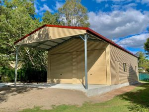 Panelform Garage 12m long x 7m wide x 3.6m high with an attached 4m long x 7m wide gable carport.